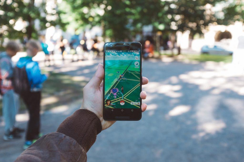 plaing mobile game pokemon go outside